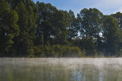 Foggy morning landscape on the river. Royalty Free Stock Photos