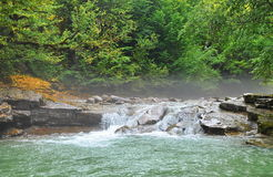 Foggy morning on mountain river Royalty Free Stock Photos