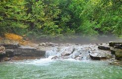 Foggy morning on mountain river Royalty Free Stock Photos