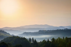 Foggy morning in mountains Stock Photography
