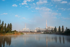 Foggy morning over the cooling pond and nuclear power plant Royalty Free Stock Photo