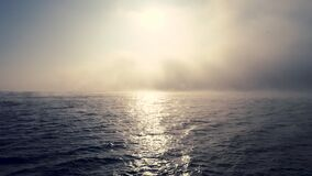 Foggy morning over ocean waves. Sunrise and ripple water, aerial view