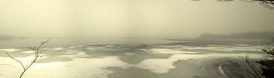 Foggy morning over spring lake Stock Photo