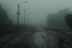 Foggy morning. Photo broken road hidden in a mysterious fog Royalty Free Stock Photo