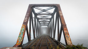 Foggy morning railway bridge.  Daybreak on Prince of Wales Railway trestle, Ottawa, Ontario. Misty fog on the Ottawa River conspires with the structural steel of Stock Image