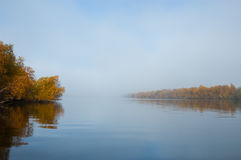 Foggy morning on a river. Mirror reflection Royalty Free Stock Images