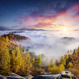 Foggy morning scene in the mountain village Babyn. Colorful autumn sunrise in the Carpathian mountains, Ukraine, Europe. Artistic style post processed photo Royalty Free Stock Photo