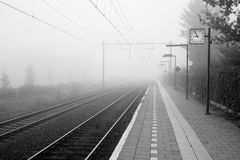 Foggy morning at small Dutch trainstation. It is a foggy October morning at the small Dutch trainstation of Almelo de Riet. It is located near Almelo in the Royalty Free Stock Images