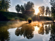 Foggy morning on a small river in russia. Stock Photography