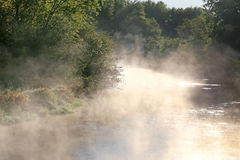 Foggy Morning with Steam Rising off River Royalty Free Stock Photography