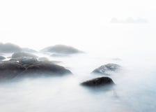 Foggy morning on the stones beach stock photos
