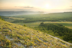 Foggy morning in summer mountains. Royalty Free Stock Photography