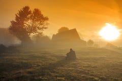 Foggy morning sunrise landscape. In Transylvania Stock Photos