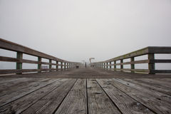 Foggy morning sunrise at pier. Fog arrives at sunrise at the St Augustine, Florida pier royalty free stock photography