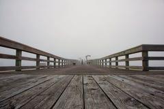 Foggy morning sunrise at pier. Royalty Free Stock Photography