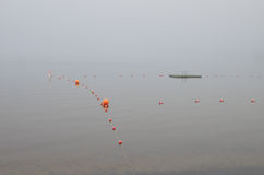 Foggy morning at swimming beach Royalty Free Stock Photo
