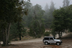 Foggy Mountain. This is a photo of a jeep parked at the top of a foggy mountain Royalty Free Stock Photo