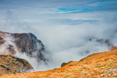 Foggy mountain landscape with clouds stock photography