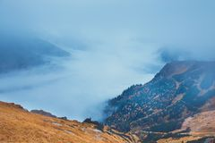 Foggy mountain landscape with clouds royalty free stock photography
