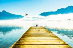 Foggy mountain landscape with seagulls on Pier of lake Mondsee i royalty free stock image