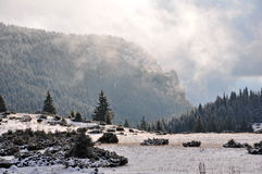 Foggy mountain landscape. A winter scene with fog shining Stock Images