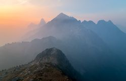 Foggy mountain range at sunset Stock Images