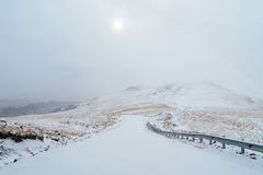 Foggy mountain road stock photography