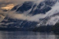 Foggy mountain scene in milfordsound fiordland national park sou. Tn island new zealand important traveling desination stock images