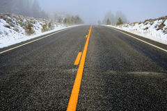 Foggy Mountain Travel. Foggy winter morning on hwy 21 between Stanley and Lowman Idaho Stock Photos