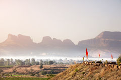 Foggy mountain valley in India. Foggy mountain valley at sunrise in the village in Nasik, Maharashtra, India Stock Photography