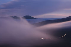 Foggy mountain valley before sunrise Stock Photo