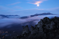Foggy mountain valley before sunrise Stock Images