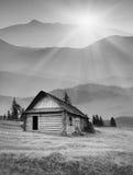 Foggy mountain village. Black and white Royalty Free Stock Image