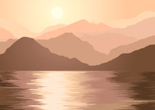 Foggy mountains and lake. In the morning Royalty Free Stock Photography