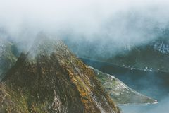 Foggy Mountains Landscape aerial view from Hermannsdalstinden summit in Norway scandinavian Stock Photos