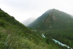 Foggy mountains and river scenic view. Altai Mountains, Russia. Foggy mountains and river scenic view. Altai Mountains stock photography