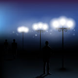 Foggy night. Foggy autumn, lamps and men Royalty Free Stock Image