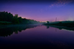 Foggy Night on countryside river Stock Photos