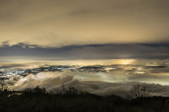 Foggy night over Varese city, Lombardy Royalty Free Stock Images