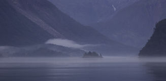 Foggy Norwegian fjord Stock Images