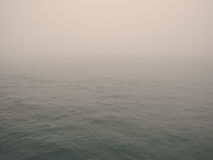 Foggy ocean. Beautiful warm foggy ocean background Stock Photos