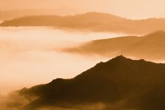 Foggy panorama at sunset Stock Photography