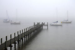 Foggy Pier. Foggy Day in Palm Bay Florida with Sailboats and a Pier royalty free stock photos
