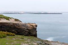 Foggy pier in Santa Cruz at dawn long exposure. Foggy pier in Santa Cruz before sunrise long exposure royalty free stock image
