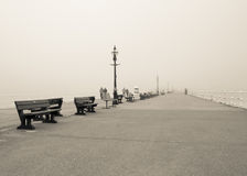 Foggy pier. Whitby west pier in thick fog stock photo