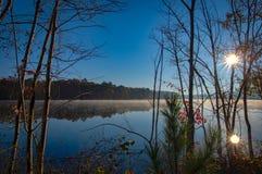 Foggy pond at sunrise stock image