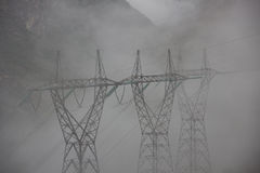 Foggy powerlines Stock Photo