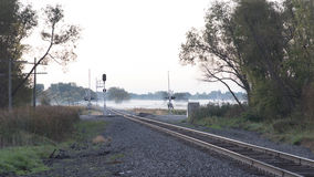 Foggy Railroad Crossing Stock Image