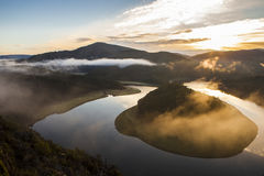 Foggy rising at Alagon River Meander, Spain Stock Images