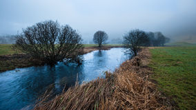 Foggy river. A river in foggy weather in Norway Royalty Free Stock Photo